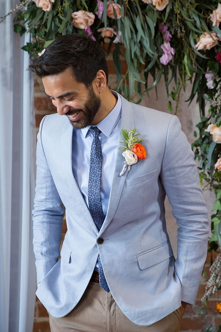 Groom wearing powder blue suit jacket with patterned tie and bright buttonhole | Anna Pretorius Photography & The Stache Photography