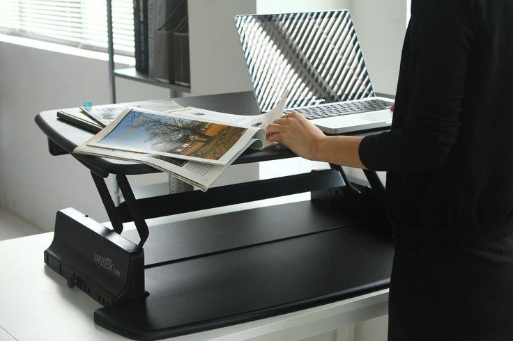 The surface of a VARIDESK desktop riser allows you to have paperwork alongside your laptop - http://uk.varidesk.com
