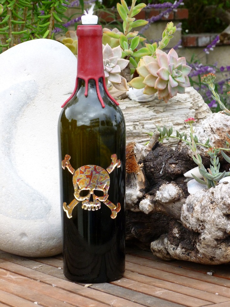 Skull and cross bones design with applied indian summer for Empty wine bottles