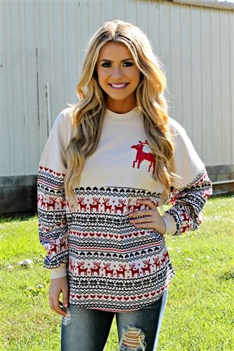Our Ugly Christmas Sweater Spirit Jersey is a khaki colored spirit jersey that features Christmas patterns across front and back of sweater in green, red and black. It also features