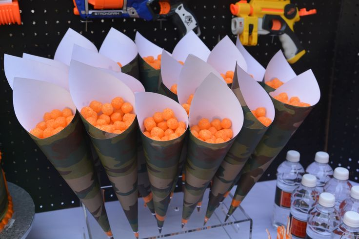 "Camo paper cones with cheese ball ""bullets"".  Used my cakepop stand to hold them"