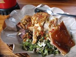 babi guling (balinese roast pork). Don't forget to try this the most delicious food when you come to Bali =D