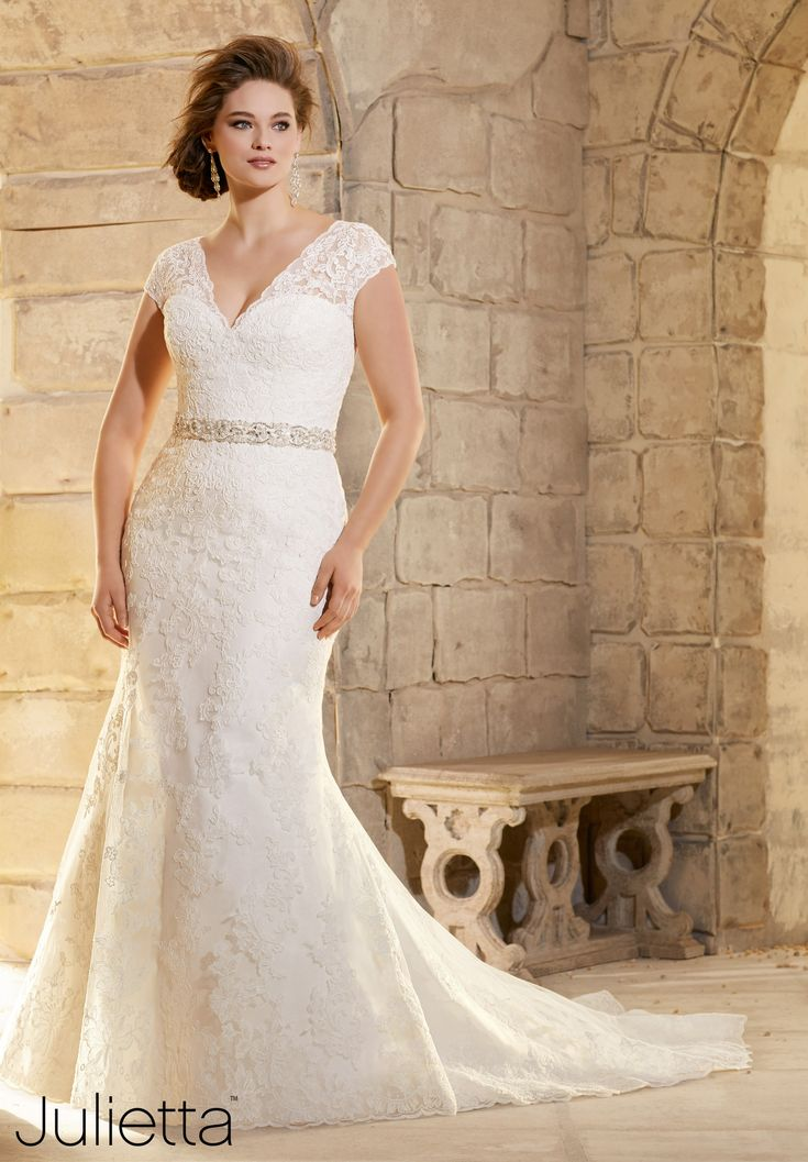 """Wedding Dresses By Julietta featuring Embroidered Appliques on Net with Wide Hemline Border Removable Beaded Satin Belt (included). Available in Three Lengths: 55"""", 58"""", 61"""" - Also sold as style 11215/ 11215W. Colors Available: White/Silver, Ivory/Silver"""
