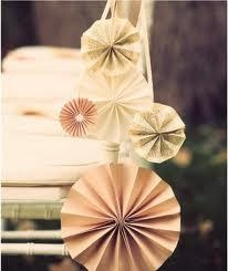 Dangle together pinwheels from ribbon/yarn to hang around doorways or off of square tables