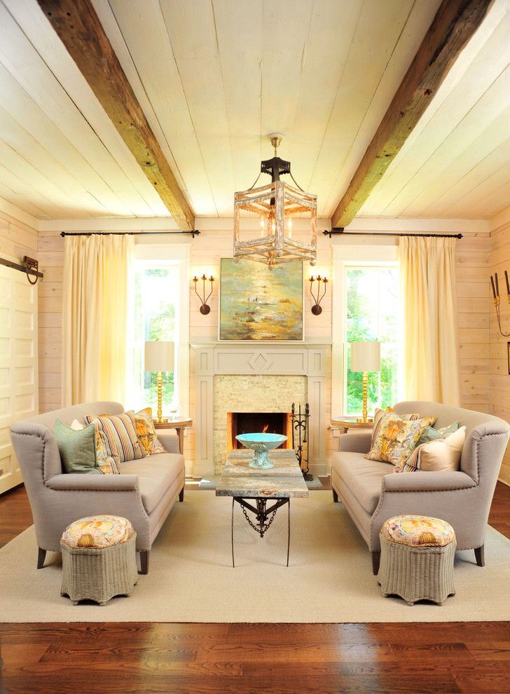 14 Fashion Forward Rooms For Every Design Lover: Small Living Room, Fireplace, Warm Tones, Sliding Barn