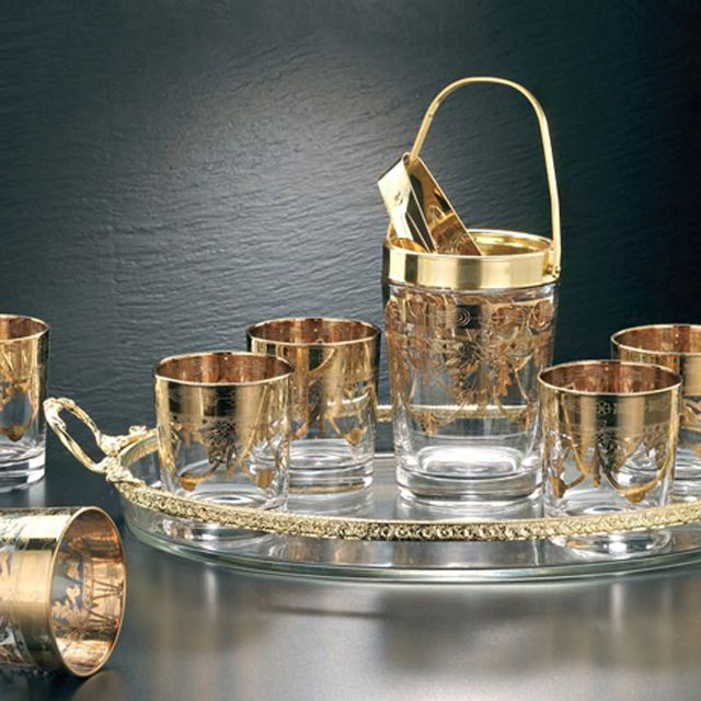 EMPIRE STYLE WHISKY SET  Set of nine pieces:  6 Whisky Glasses 1 Ice Bucket: with pantograph and gold finishing 1 Ice tong in brass and gold plated 24% 1 Oval Glass Tray with brass gold plated 24%