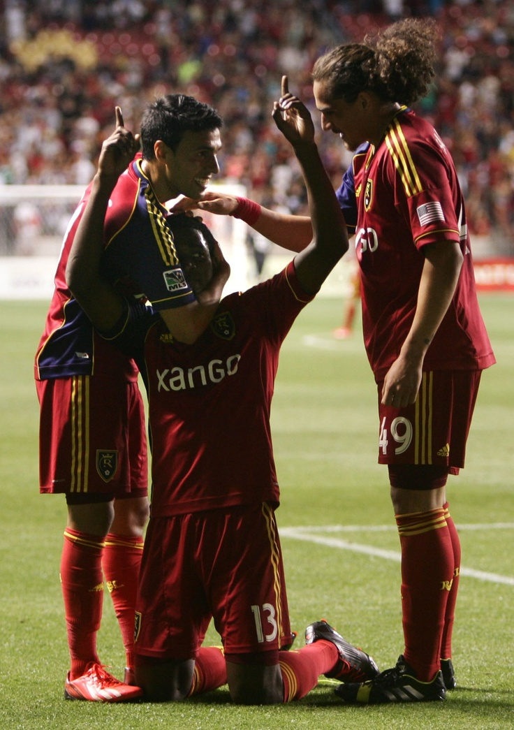 (middle) Real Salt Lake forward Olmes Garcia (13) celebrates scoring his second goal against the Los Angeles Galaxy with teammates (left) Real Salt Lake midfielder Javier Morales (11) and (right) Real Salt Lake forward Devon Sandoval (49) during the second half at Rio Tinto Stadium in Salt Lake City on June 8, 2013.  Real went on to win the game 3-1. (Kim Raff  |  The Salt Lake Tribune)