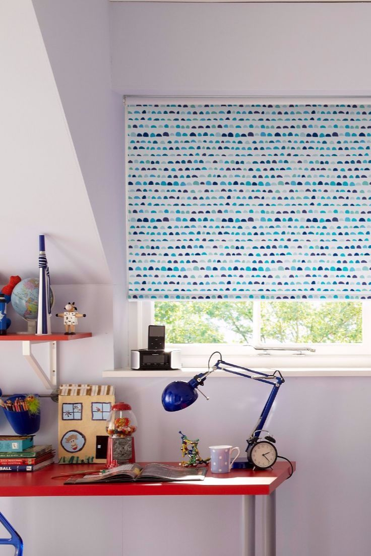 Love blue? Our Herald Blue Roller blind might just be the perfect choice for you! The design features small half-moon shapes in a range of different shades of blue from turquoise to indigo all with a hand-drawn feel. It's a one-of-a-kind design that'll definitely turn heads!