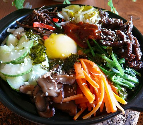 Bi bim bap. (Korean) Assorted yumminess atop rice. One of my favorite things to eat.