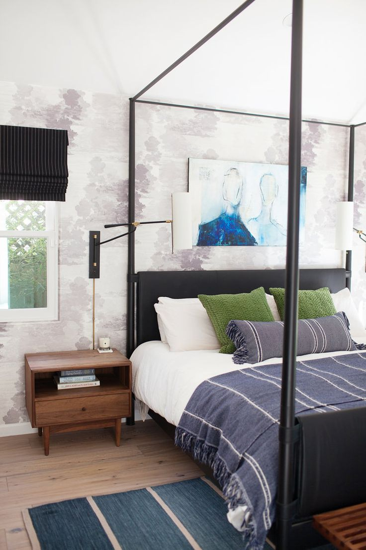 Black canopy bed in a modern eclectic