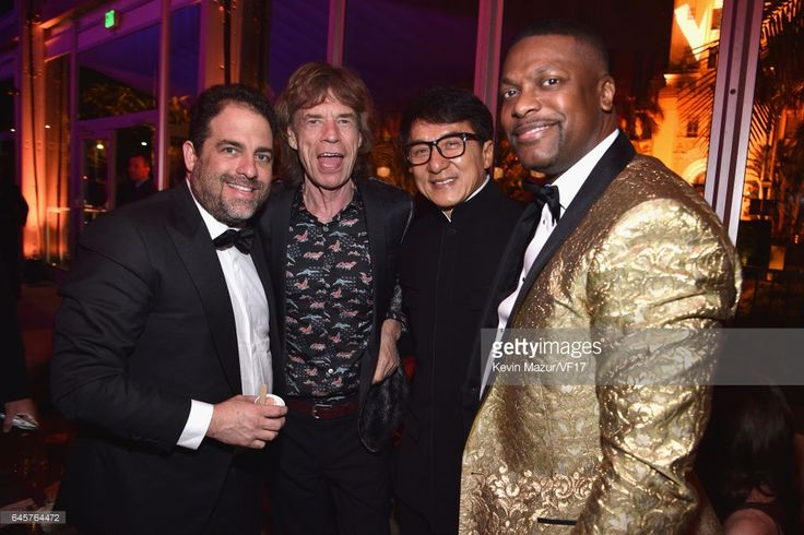Brett Ratner, Mick Jagger, Jackie Chan and Chris Tucker attend the 2017 Vanity Fair Oscar Party hosted by Graydon Carter at Wallis Annenberg Center for the Performing Arts on February 26, 2017 in Beverly Hills, California.