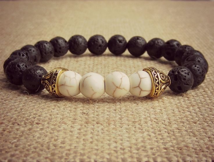 Essential oil bracelet featuring lava and white howlite stones. Visit my FB page for more details. ⬇️
