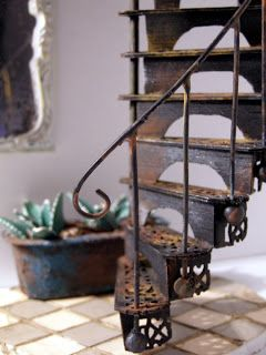 Victorian spiral staircase - outstanding tutorial.  Made out of a fan, balsa wood sheet an wire.