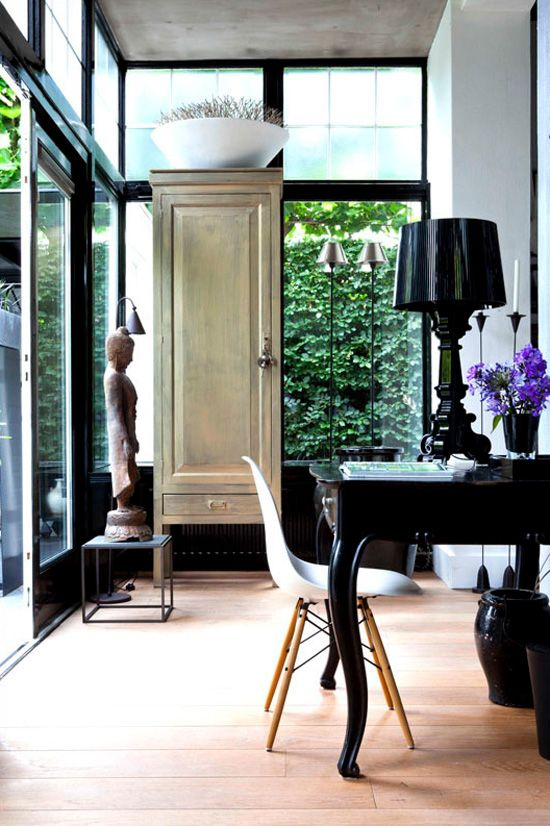 Office in the green   Bourgie lamp by Ferruccio Laviani