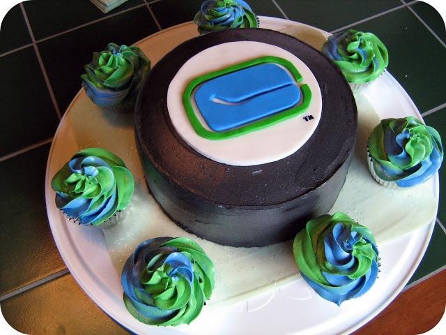 hockey cake, puck cake, canucks cake