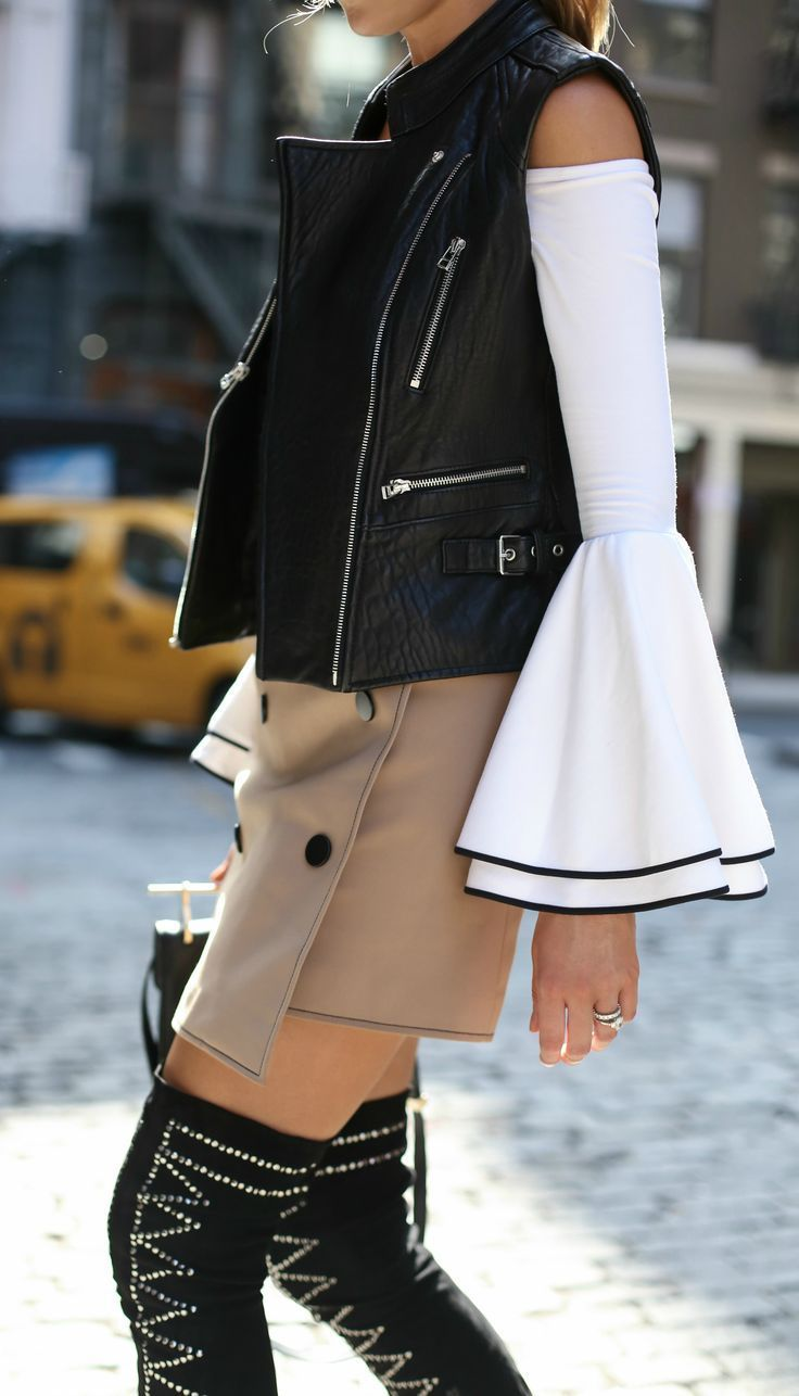 Streetstyle from soho: off-the-shoulder bell sleeve top with black piping, khaki double breasted mini skirt, black over-the-knee studded boots, black leather vest