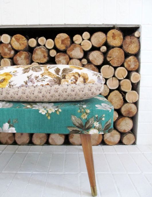 I'm in love with this footstool...and the firewood display behind. makes storage seem more like a piece of art!