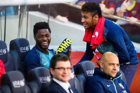 Alex Song and Neymar Santos Jr of FC Barcelona share a laugh on the bench during the La Liga match between FC Barcelona and CA Osasuna at Camp Nou on March 16, 2014 in Barcelona, Catalonia.
