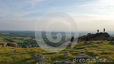 Hikers enjoying the sun going down over burrator on Dartmoor National Park . DEVON Uk