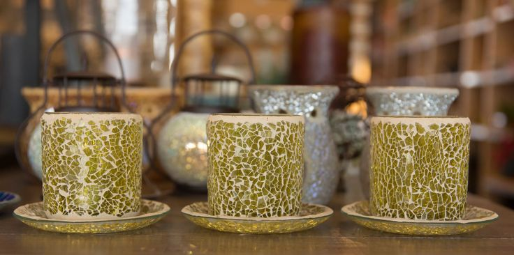 Pretty gold mosaic candle holders available in store at Chandelle Galerie.