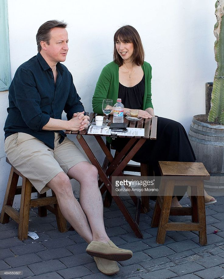 British Prime Minister David Cameron (L) and his wife Samantha (R) stop for a drink by a beach during their holiday on the Spanish Island of Lanzarote on April 13, 2014 in Teguise, Lanzarote, Spain.