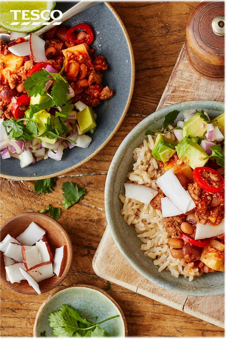 This spicy, vegan chilli recipe is a great alternative to the traditional meaty chilli con carne. It's packed with meat-free mince, tons of veg, and served with creamy avocado, zingy lime and fresh coconut. | Tesco