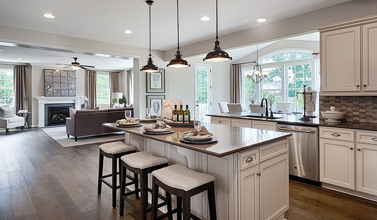 Walls of windows flood this well-appointed Aldie, VA, kitchen with natural light| Amherst plan by Richmond American
