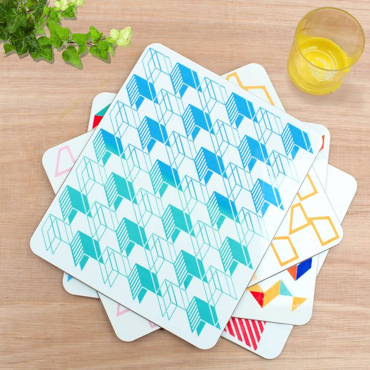 Set of four high quality, stylish melamine placemats featuring vibrant geometric contemporary designs.The popular range includes four different designs which can be bought as the mixed set of four, or up to 6 of the same design. These designs are also available in coasters and bone china mugs, as well as bags, cushions and laptop sleeves.A stunning addition to the popular Geometric collection in Rolfe & Wills' signature style using bold colour with Geometric surface pattern. Featur...
