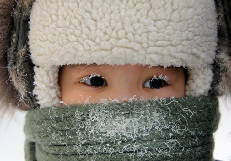 A child, with eyelashes covered with hoarfrost, along a street in the eastern Siberian city of Yakutsk in Sakha (Yakutia) Republic, Feb. 10, 2012. The air temperature in Yakutsk is about minus 35 degrees Celsius (minus 31 degrees Fahrenheit).