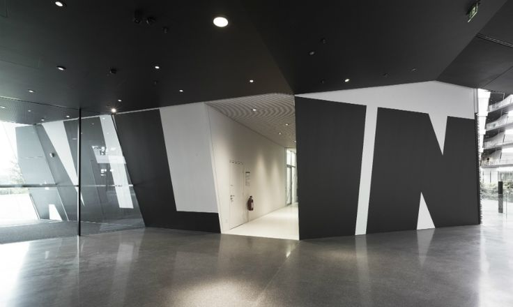 At the Adidas research and design center in Herzogenaurach, Germany, Uebele's turbocharged graphics jump across and through walls.