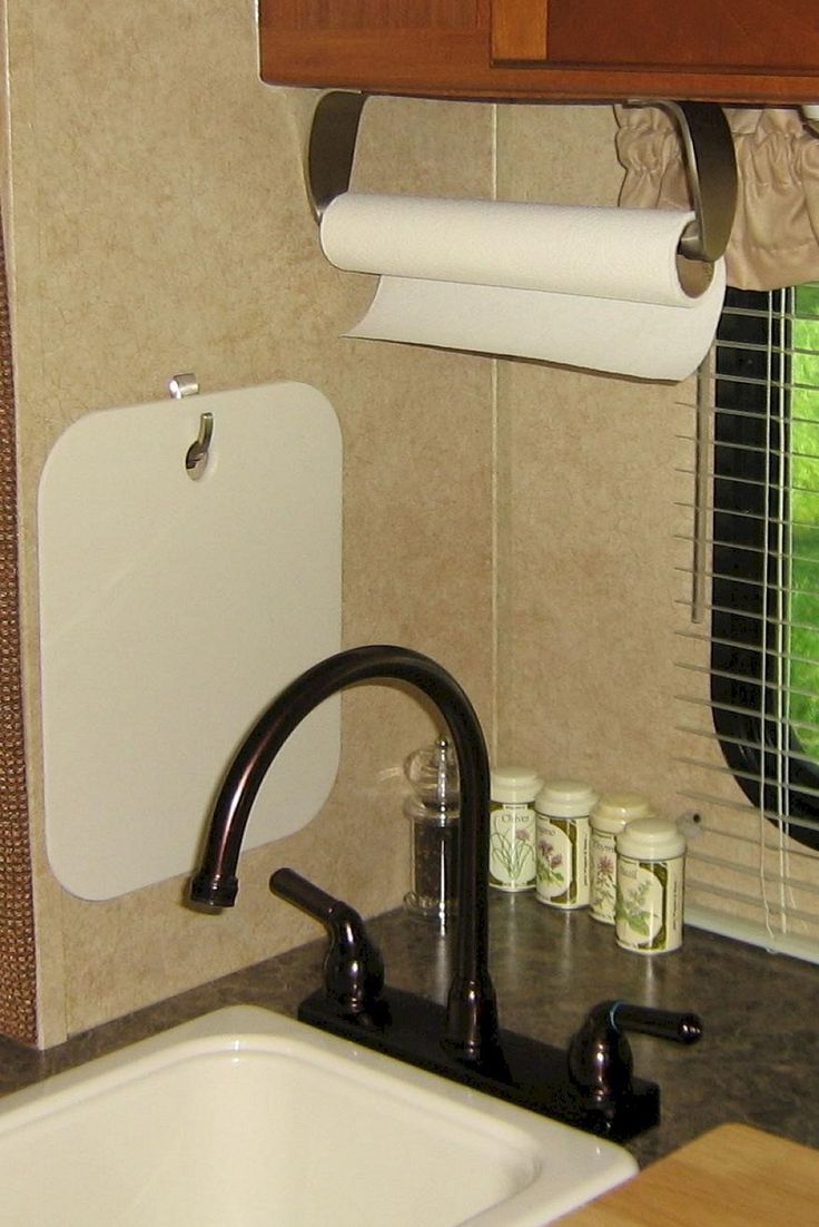 Hanger for paper towel. Hook for cutting board. Insanely Awesome Organization Camper Storage Ideas Travel Trailers No 32