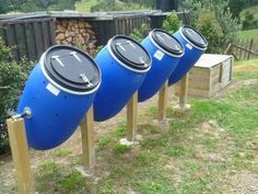 a row of compost tumblers DIY