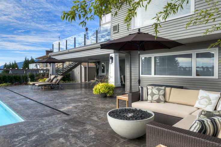 """A stunning patio and pool deck using Stone Event's """"Carbon Vein"""" Limestone in North Vancouver, BC. © A.Sirois Photography"""