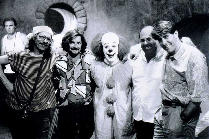 Tim Curry as Pennywise the Dancing clown behind the scenes with crew on the set of #IT (1990).