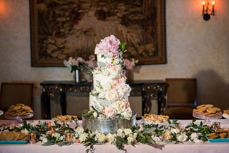 The cake table flourished with sweet and decadent treats