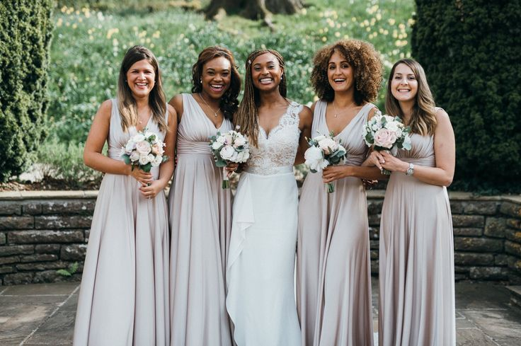 Very pale pink blush-coloured full-length bridesmaids dresses with ivory and blush bouquets. Coombe Lodge, Blagdon, Somerset.