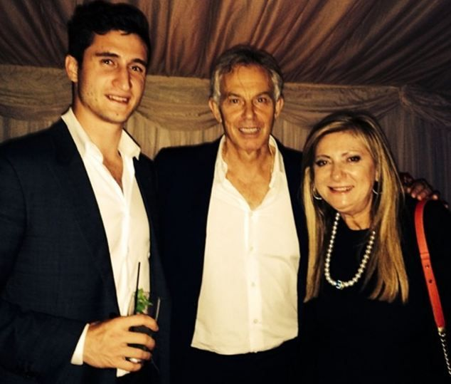 In the marquee: Tony Blair is flanked by guests Michael Pennisi and Sarina Russo at Friday...