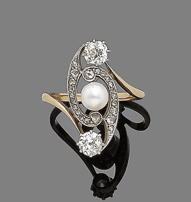 An art nouveau cultured pearl and diamond-set dress ring, circa 1910  Centrally set with a cultured pearl within a rose-cut diamond swirl, terminating in old-brilliant-cut diamonds, diamonds approx. 0.85ct total