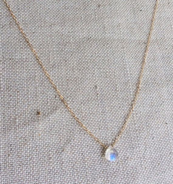 This is a tiny Moonstone necklace. The gold moonstone necklace is gold filled. The rainbow moonstone necklace is very tiny. The size of the