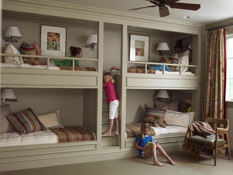 built in four 4 bunk beds in one room . Clever design with stairs in the middle.Great for grandchildren sleepovers!