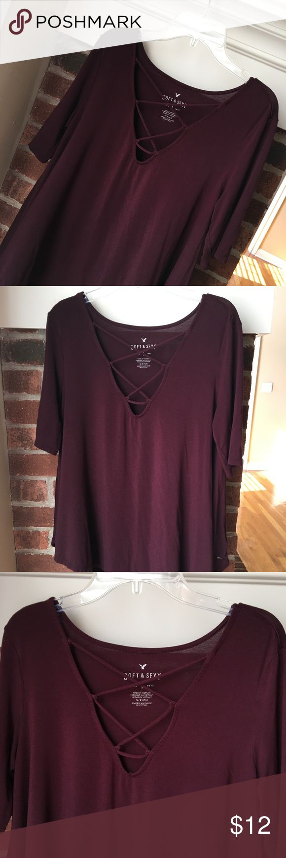 """AE Soft & Sexy Short Sleeve Lace Up Tee Sz S Burgundy American Eagle Soft & Sexy Short Sleeve Tee Size Small. Super soft fabric with just enough stretch and designed to drape. Lace-up v-neck. Sewn Eagle metal logo piece at the bottom. 95% Viscose, 5% Elastane. Stock picture in a different color (to show fit). Good condition. Length from shoulder is about 25"""" in the front (28"""" in the back), Chest is about 36"""". Kept in a smoke free home. American Eagle Outfitters Tops Tees - Short Sleeve"""