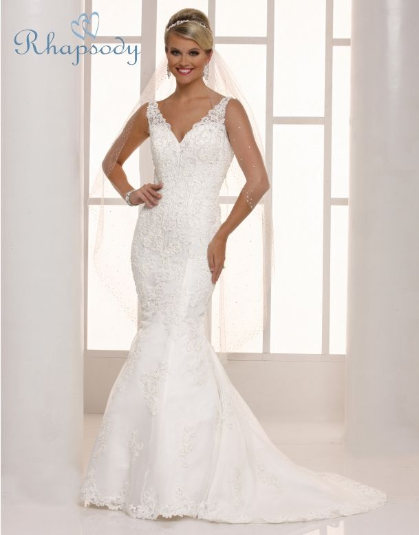 Rhapsody  Style #R7701  Enticing bridal sheath with tank straps has lavish lace applied all over the bodice, skirt and hem. There is a sweetheart neckline, a pretty open V back and a chapel train.