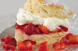 Strawberry Shortcake is composed of a scone or biscuit that is cut in half and filled with whipped cream and lightly sweetened strawberries. From Joyofbaking.com With Demo Video