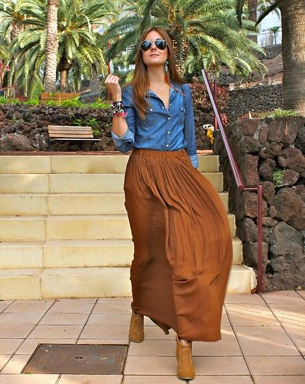 oh, the versatility of a denim shirt. i love the pairing of the maxi skirt with this and some vibrant jewelry. kudos