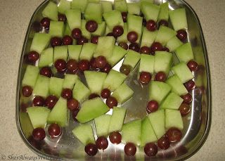 Hulk Snacks - green melon and red grapes held together with a toothpick are a fun way to emulate the Hulk's iconic color scheme with a healthy party snack