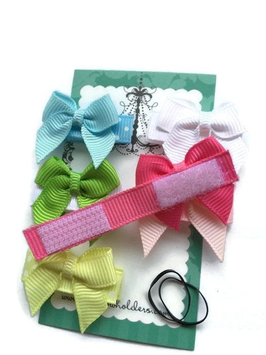 ~ ~ ~ ITEM DESCRIPTION ~ ~ ~ THIS LISTING IS FOR a 6-pack of INFANT VELCRO HAIR PRETTIES!!! This Packet includes: 6 traditional bows (hot pink, light pink, blue, yellow, green and white) Each bow measures approximately 1 inch. They are soooo cute and soft. Enjoy these Infant Hair Pretties. As seen in Nordstrom's!! Simply squeeze into newborn's fine hair…all of these are pure velcro, velvet or grosgrain and an embellishment or two! No heavy clips. Perfect for the infant! HOW DO THEY W...