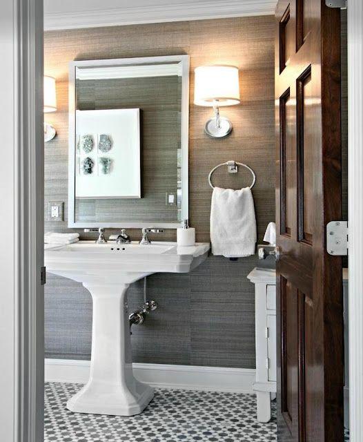 Grey grasscloth wallpaper and pedestal sink
