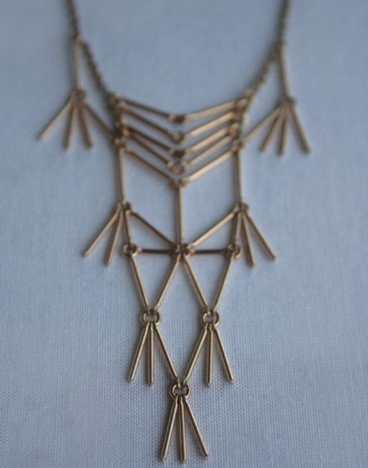 a necklace by Language Jewelry.