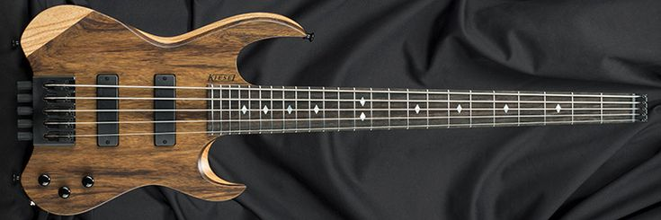 Kiesel Guitars VB5, clear satin finish (CS), swamp ash body (ASH), black limba top (LMBT), 5 maple neck/strips (5MM), Luminlay side dots (SDL), mother of pearl diamond inlays (DMP), regular stainless frets (STRF), ebony back plate (BPE), m22t bridge pickup (45), Dunlop straplocks (SL), radiuses single coil pickups (RJ2), black logo (BL)