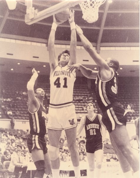 Villanova basketball alum Chuck Everson will throw out the first pitch at the Yankees game tomorrow night. Here is a picture of Chuck scoring on Auburn's Charles Barkley.